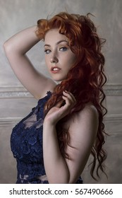 portrait of beautiful redhaired woman dressed in blue lace dress