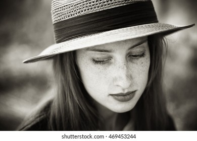 Portrait of a beautiful redhead girl in hat