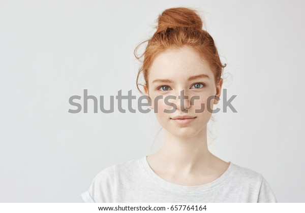 Portrait of beautiful redhead girl smiling looking at camera.