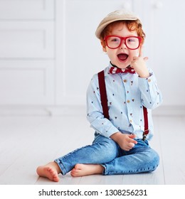 portrait of beautiful redhead toddler baby boy
