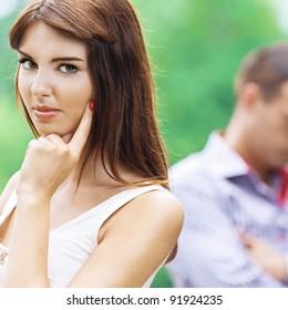 portrait beautiful romantic young woman behind sad man background green summer park