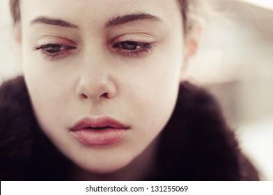 portrait of a beautiful sad girl closeup