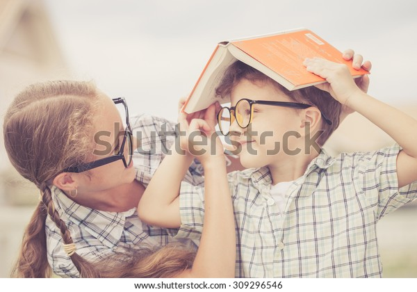 Portrait of Beautiful school boy and girl looking very happy outdoors at the day time. Concept school theme.