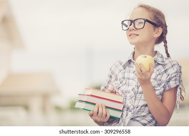 Portrait of Beautiful school girl looking very happy outdoors at the day time. Concept school theme.