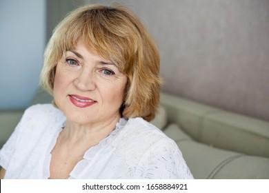 Portrait of a beautiful senior blonde woman, closeup