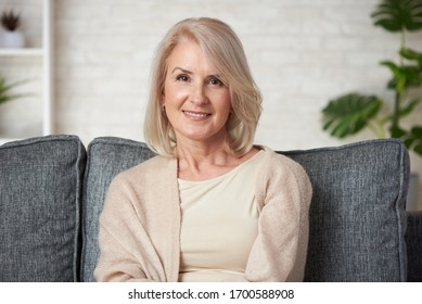 Portrait of a beautiful senior blonde woman smiling at home.