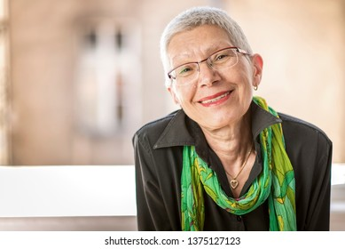 Portrait of beautiful senior business woman with white, grey hair