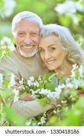 Portrait of beautiful senior couple hugging in spring park