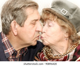 Portrait of beautiful senior couple kissing