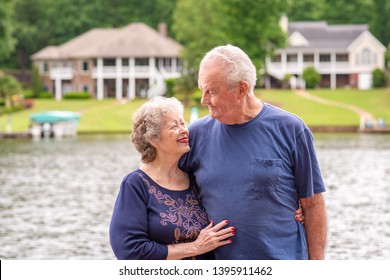Portrait of a beautiful senior couple in love, celebrating a long, happy marriage and successful retirement.