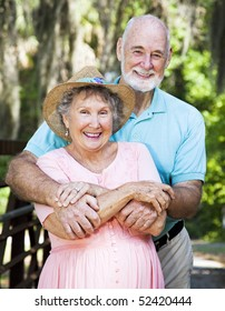 Portrait of beautiful senior couple in natural outdoor setting.