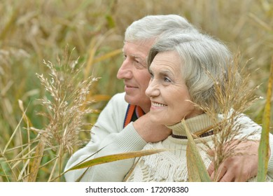 Portrait of a beautiful senior couple standing in autumn at nature