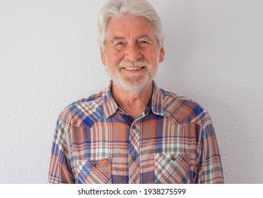 Portrait of beautiful senior man, white-haired with beard looking at camera