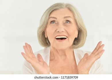 Portrait of beautiful senior woman at home