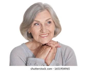 Portrait of beautiful senior woman, posing against white background