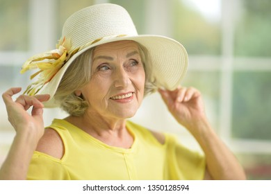 Portrait of beautiful senior woman in yellow dress