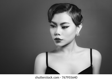 Portrait of beautiful sensual asian woman with elegant hairstyle and perfect makeup.