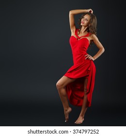 Portrait of Beautiful Sensual Woman in Fashion Red Dress.