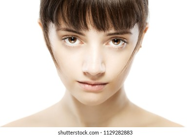 portrait of a beautiful serious girl looking at camera