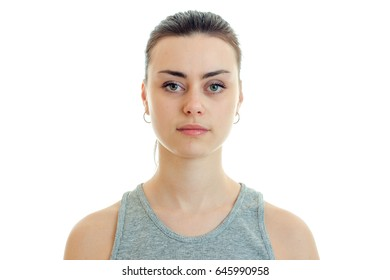 Portrait of beautiful serious girl who stands up straight and looking at camera