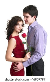 Portrait of beautiful sexual couple with red rose over white