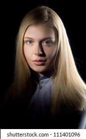 Portrait of the beautiful sexual girl of the blonde, picture in low key