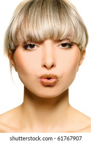 Portrait of the beautiful sexual girl to blonde with spangle on lip on white background