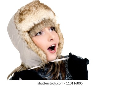 Portrait of the beautiful sexual girl in warm hat and sweater on white background