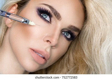 Portrait of beautiful, sexy blonde woman, with perfect face and beautiful hair. Beauty model during the procedure of aesthetic medicine.
