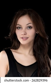 Portrait of beautiful sexy brunette girl on a black background