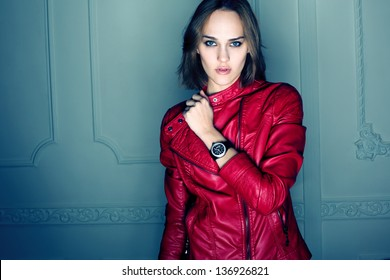 Portrait of beautiful sexy fashion girl wearing red coat and black watch