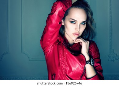 Portrait of beautiful sexy girl wearing red jacket and black watch
