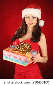 Portrait of beautiful sexy girl wearing santa claus clothes, studio
