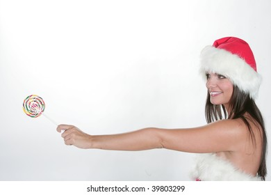 Portrait of beautiful sexy girl wearing santa claus clothes with a Barley sugar on white background