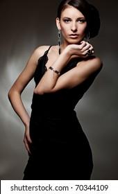 portrait of beautiful sexy model in black dress