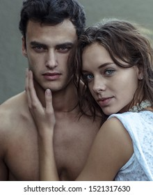Portrait of beautiful sexy model woman and man couple looking into the camera. Passionate, love, and beauty concept.