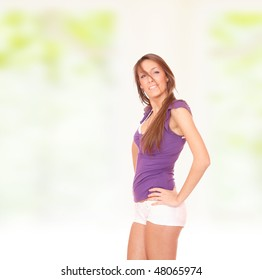 Portrait of a beautiful sexy spring girl on green background