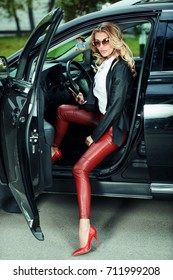 Portrait of a beautiful sexy  woman in a car. Beauty, fashion. Outdoor summer portrait.