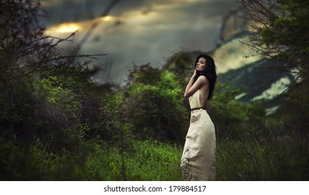 Portrait of beautiful sexy woman in field. Celtic style