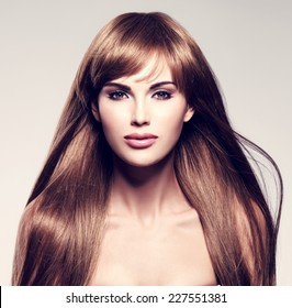 Portrait of the beautiful sexy woman with long  hair. Fashion model with straight hairstyle