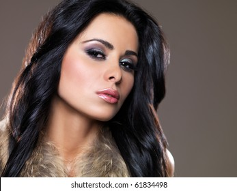 Portrait of beautiful and sexy woman on natural background