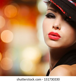 Portrait of the beautiful sexy woman with red lips in modern black hat