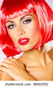Portrait of beautiful sexy woman in red wig