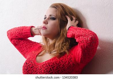 Portrait of beautiful sexy woman smoking a cigarette.