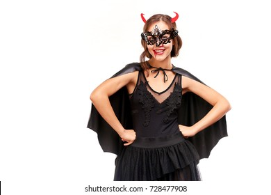 Portrait of beautiful she-devil posing on Halloween against white background