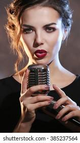Portrait of beautiful singing woman, close up