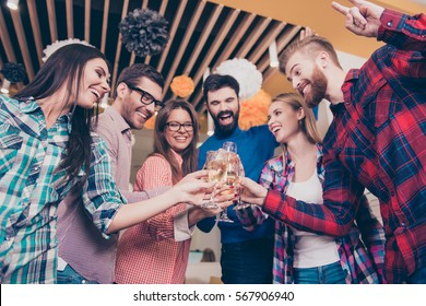 Portrait of beautiful six carefree happy friends  clinking glasses of wine with toast in campus. freelancers relaxing and having dancing cool party.