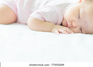 Portrait of a beautiful sleeping newborn baby girl sleeping on bed., Concept of love. Selective focus., close-up., Background. Copy space