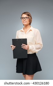 Portrait of a beautiful smart girl holding folder isolated on the white background