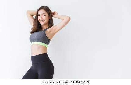 Portrait of beautiful smile healthy armpit asian woman body curve sport wear copy space white background. People beauty perfect body slim fitness girl. Freedom happy relax lifestyle healthcare concept